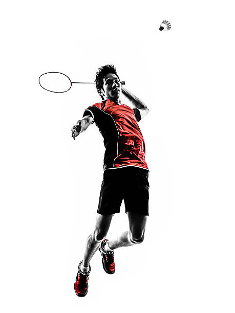 badminton player young man silhouette - badminton sport stock pictures, royalty-free photos & images