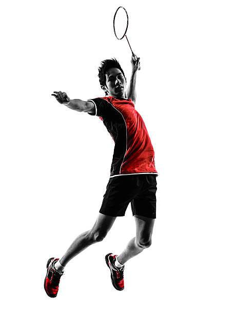 Jovem silhueta de Jogador de badminton - foto de acervo