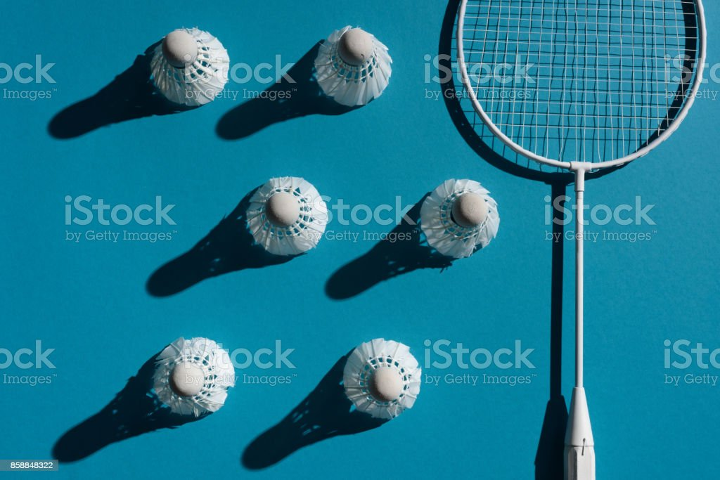 badminton racket and shuttlecocks stock photo