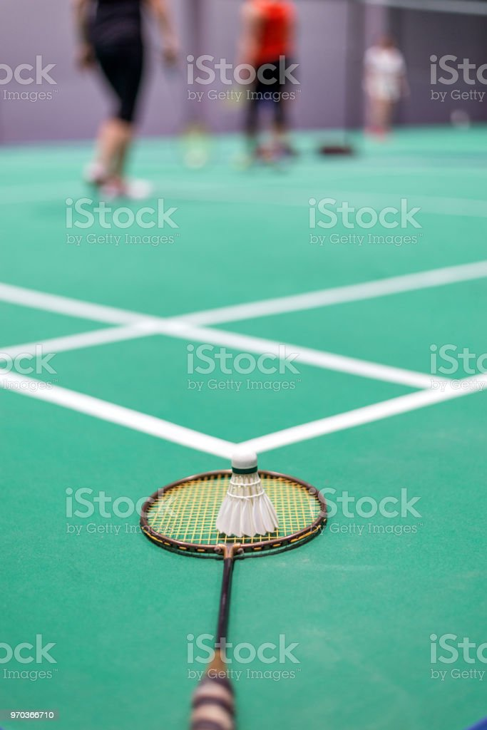 badminton shuttlecock and racket on court. stock photo