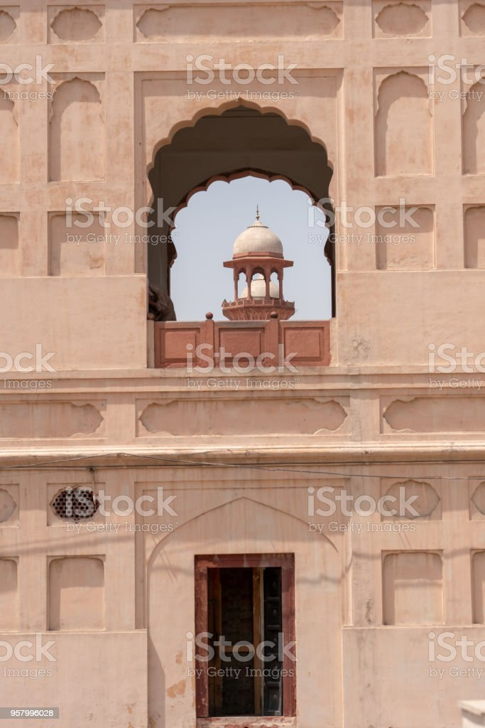 Badshahi Mosque Dome From A Window Of Lahore Fort Stock Photo