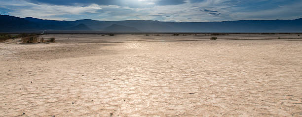 Badwater Basin Death Valley Death Valley is a desert valley located in Eastern California. It is the lowest, driest, and hottest area in North America. lake bed stock pictures, royalty-free photos & images