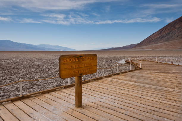 Boardwalk and Sign at Badwater Basin stock photo
