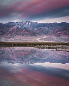Badwater Basin Sunrise in Death Valley National Park - Reflection of snowcapped mountain during blue hour