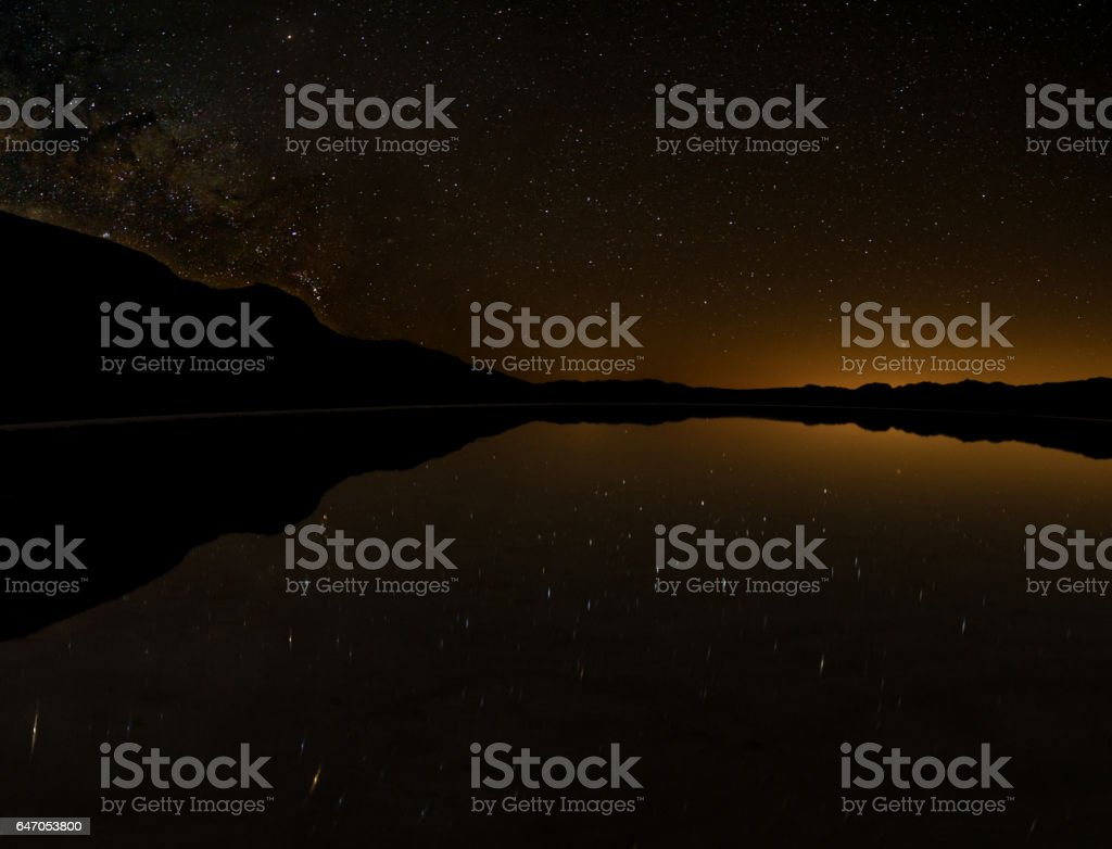Badwater Flood Reflects Night Sky stock photo