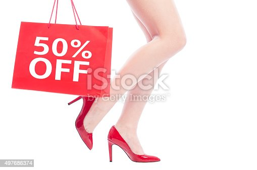 50 off or fifty percent discount for woman shoes concept with sexy female legs wearing red shoes