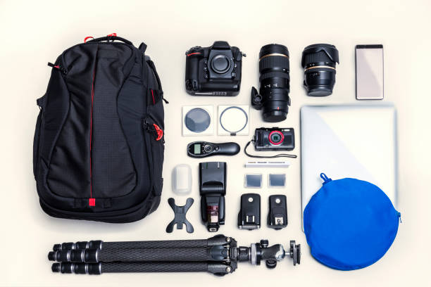 bag and camera set - camera photographic equipment stock photos and pictures
