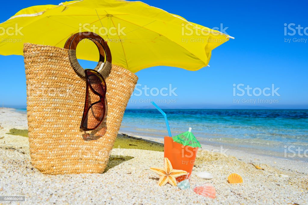 bag and other summer objects on the beach royalty-free stock photo