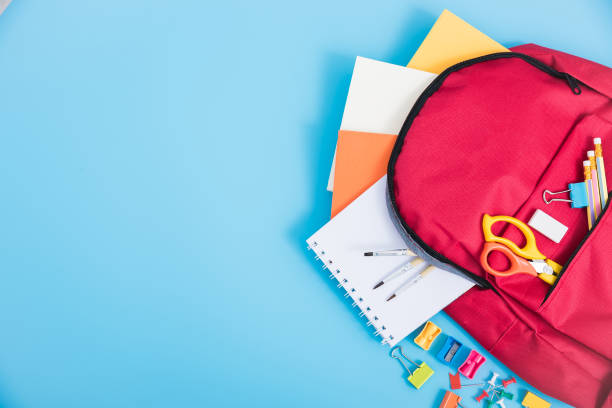 bag backpack for education children Top view Red bag backpack for education children on blue background back to school concept back to school stock pictures, royalty-free photos & images