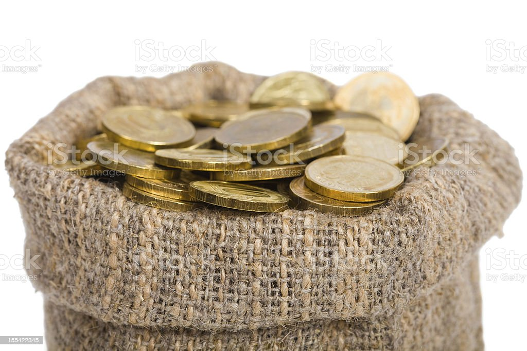 Bag filled with coins. royalty-free stock photo
