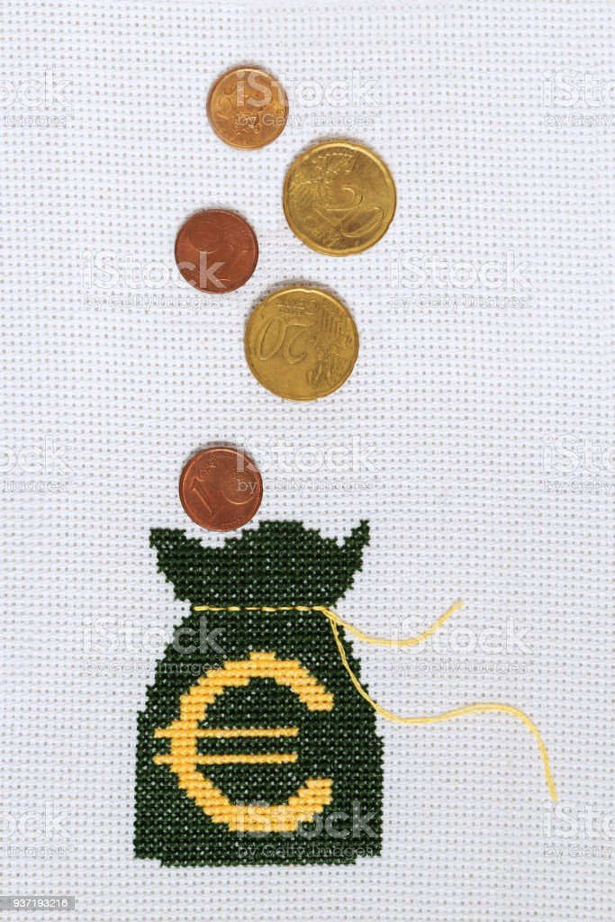 A Bag For Money With A Euro Symbol Embroidered On White Fabric Stock