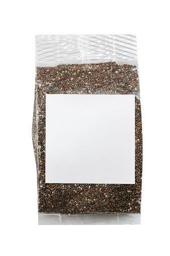 Dark seed in plastic bag with blank label, white background, clipping path
