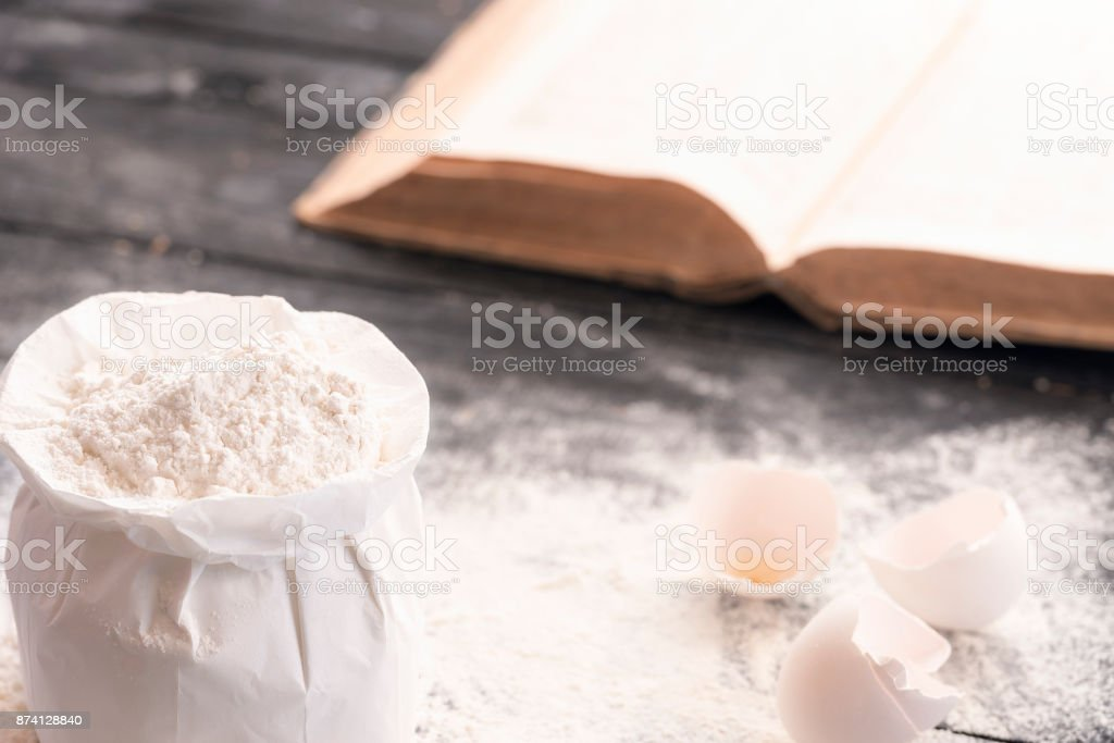 Bag of flour and a cookbook stock photo