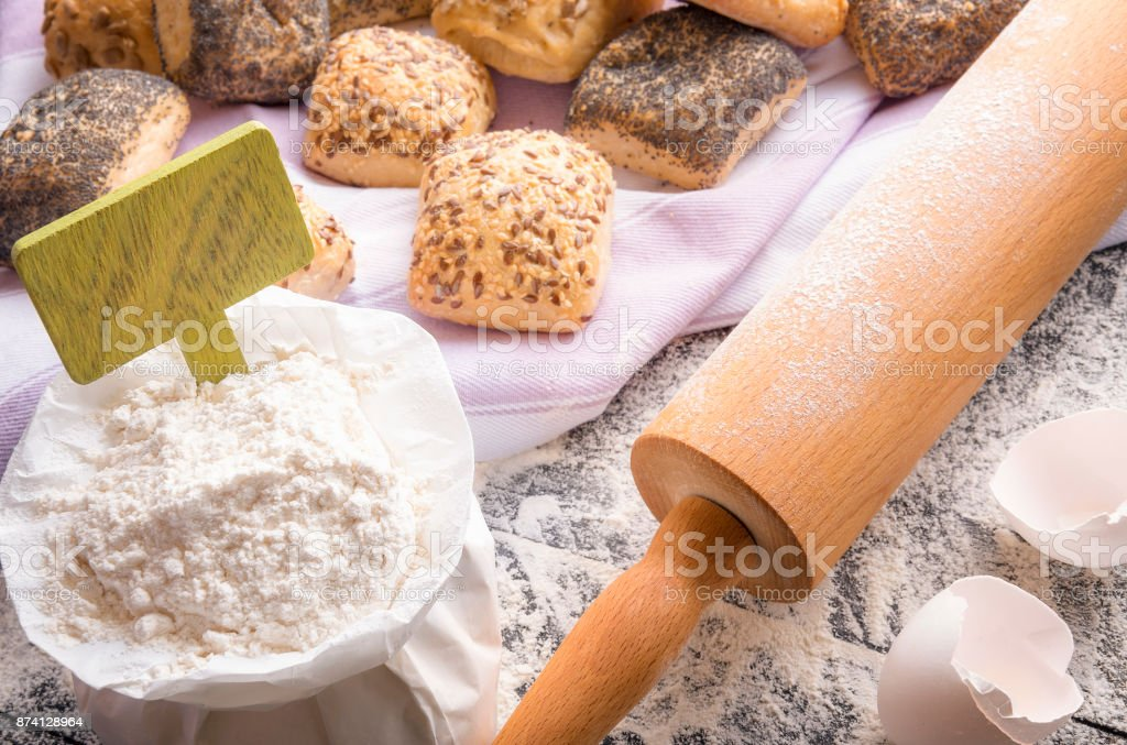 Bag of flour with banner and buns stock photo