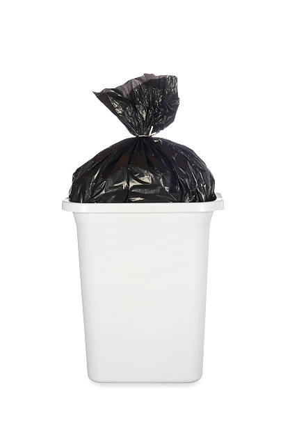 Bag of garbage in trash can stock photo
