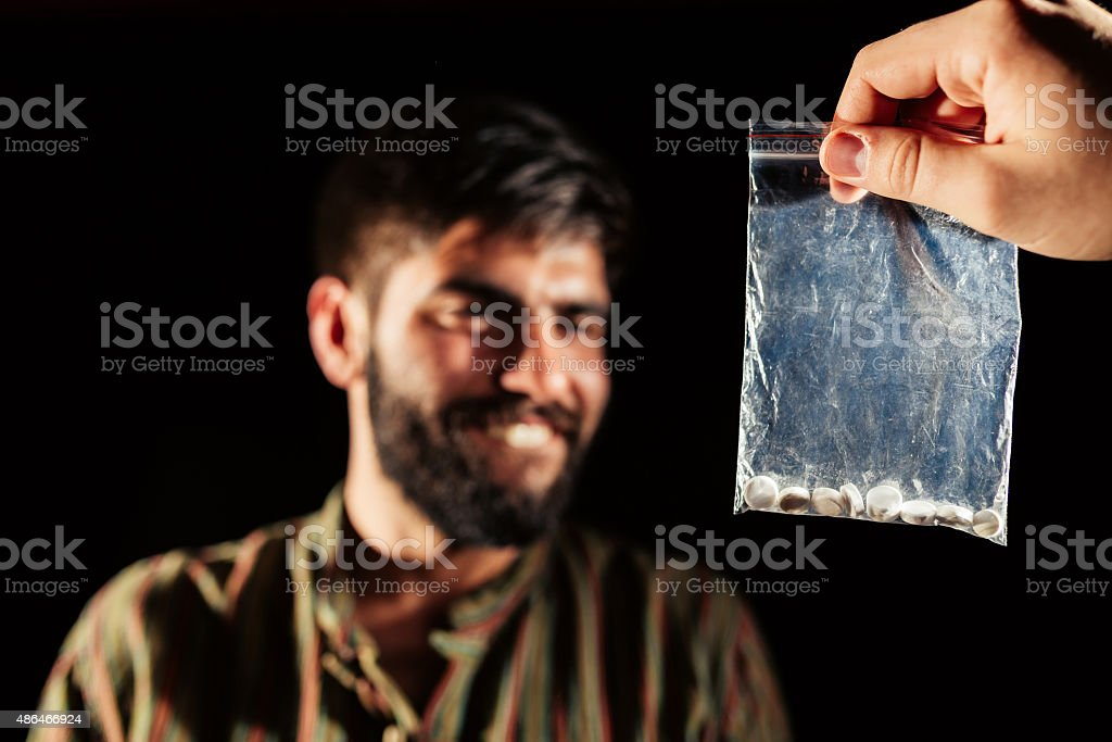 Bag of illegal pills stock photo