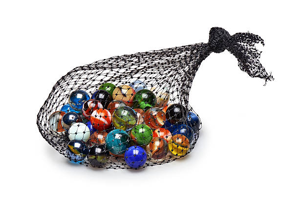 Bag of Multicolored marbles isolated stock photo