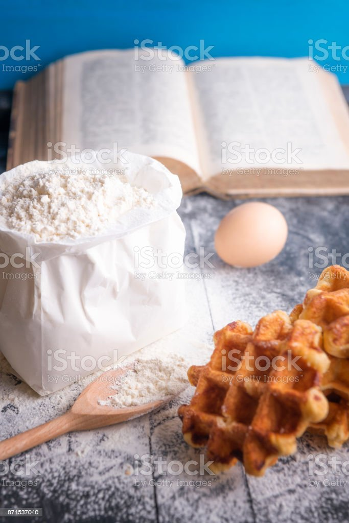 Bag of wheat flour and waffles stock photo