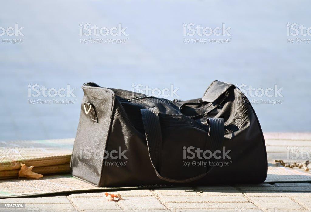 Bag on the pavement stock photo