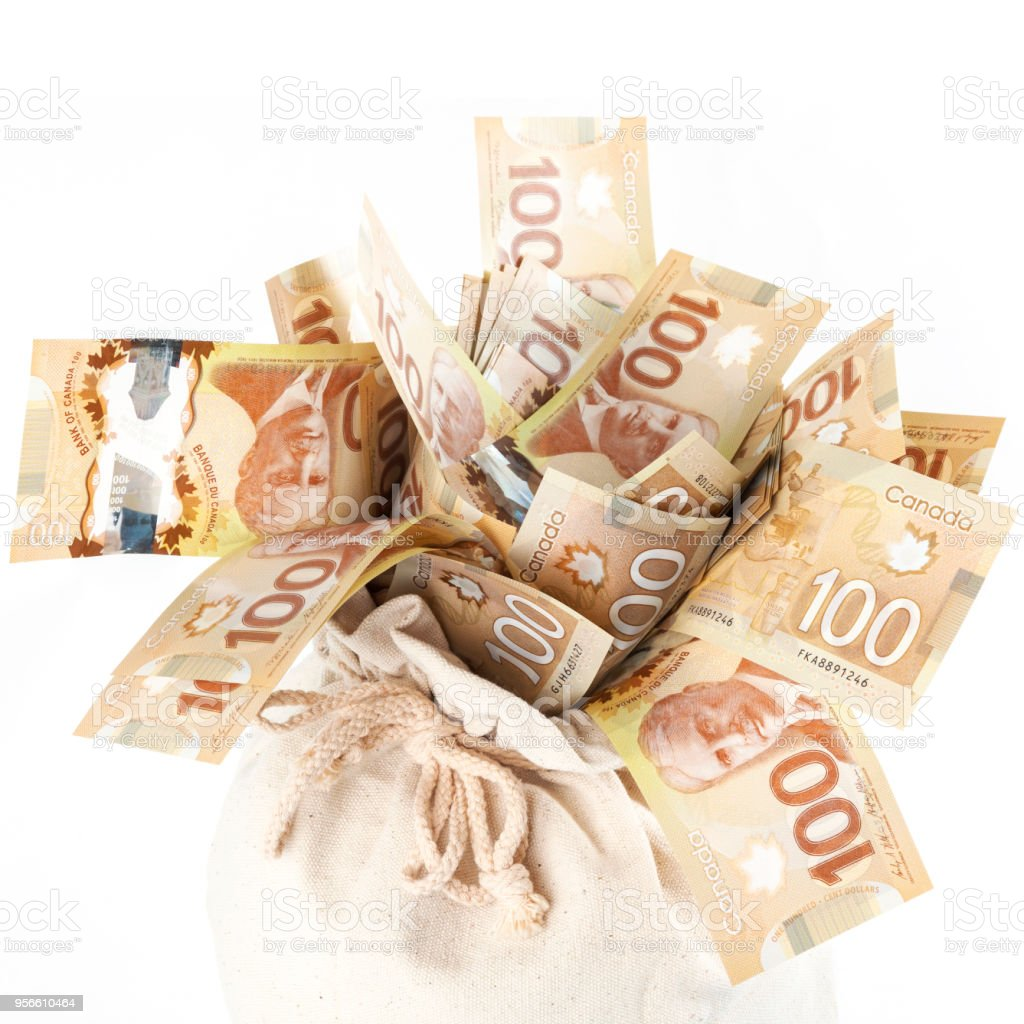 Bag Overflowing with Money - Canada stock photo