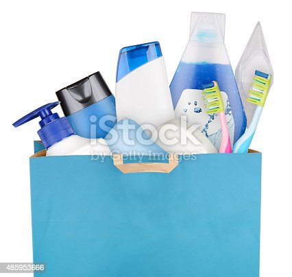 Bag with detergents and cosmetics isolated on white background