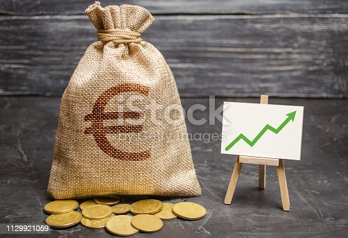 Bag with euro money and green arrow up on the chart. Success, achieving good results. The concept of increasing profits and revenues, increasing capital and increasing the efficiency of a business.