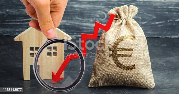 istock Bag with euro sign, house and down arrow. The concept of falling real estate market. Reduced interest in the mortgage. A decline in property price. Low interest rates on mortgage loans. Drop in demand 1133143977