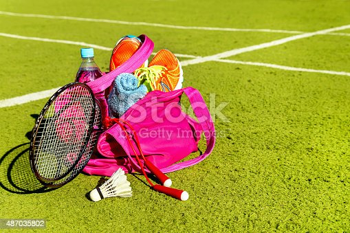 istock Bag with sports equipment on the sports courts background. 487035802