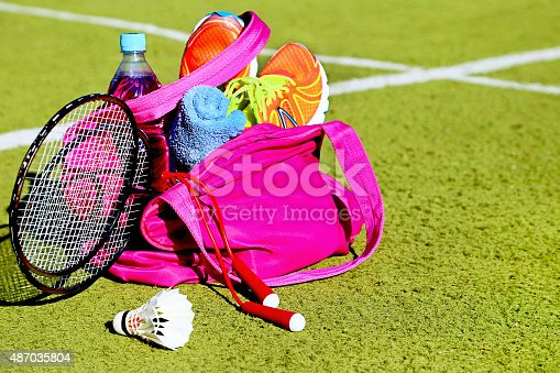 istock Bag with sports equipment on the sports courts background. 487035804