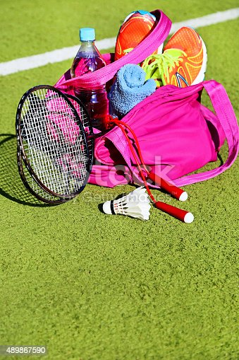 istock Bag with sports equipment on the sports courts background. 489867590