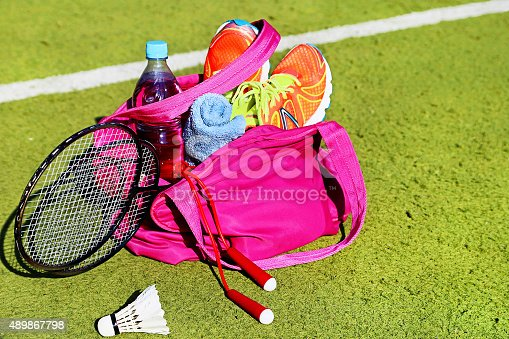 istock Bag with sports equipment on the sports courts background. 489867798