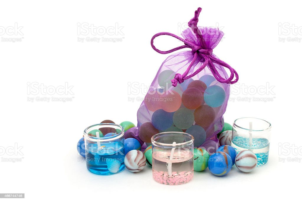 bag with stones and candles on a white background stock photo