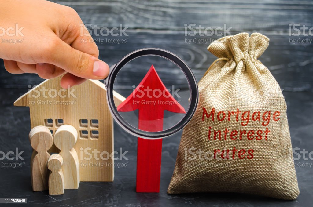 Bag with the money and the word Mortgage interest rates and up arrow...