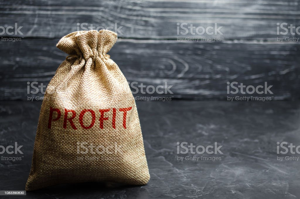 Bag with the money and the word Profit. The concept of accumulating money. Savings income. Financial management. Budget allocation. Business and Finance. Revenues and wages. Salary stock photo