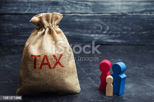 1145921132istockphoto A bag with the word Tax and family. Taxes on real estate, payment. Penalty, arrears. Register of taxpayers for property. Law-abiding, evasion of payment. Court law. Luxury tax. 1081371986