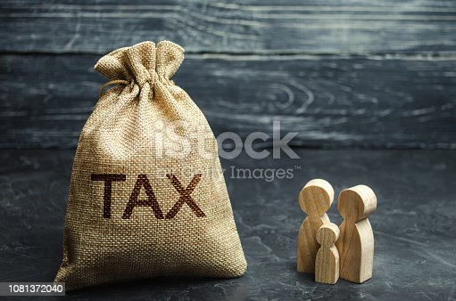 1145921132istockphoto A bag with the word Tax and family. Taxes on real estate, payment. Penalty, arrears. Register of taxpayers for property. Law-abiding, evasion of payment. Court law. Luxury tax. 1081372040