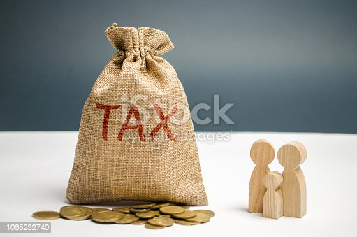 1145921132istockphoto A bag with the word Tax and family. Taxes on real estate, payment. Penalty, arrears. Register of taxpayers for property. Law-abiding, evasion of payment. Court law. Luxury tax. 1085232740