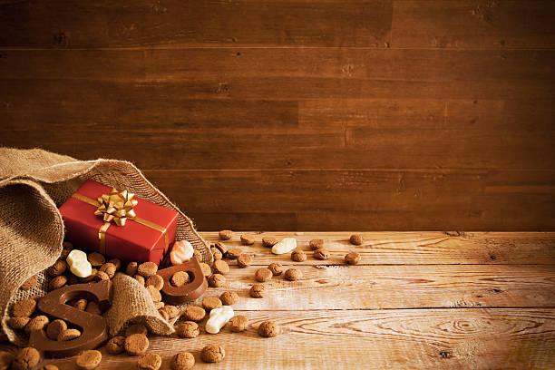 bag with treats, for traditional dutch holiday 'sinterklaas' - kruidnoten stockfoto's en -beelden