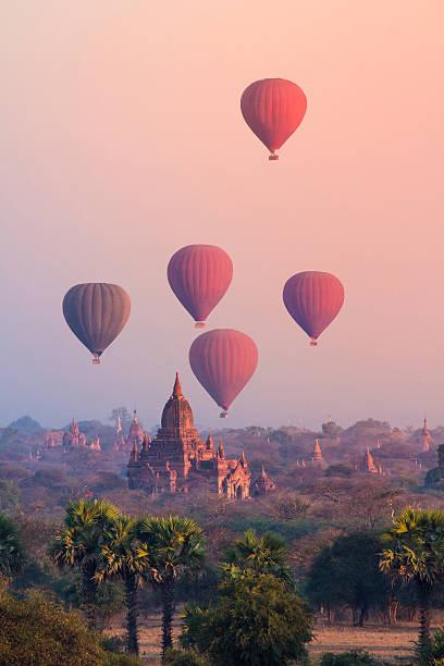Bagan, Myanmar Hot air balloon over misty morning around Temple in Bagan , Myanmar myanmar stock pictures, royalty-free photos & images