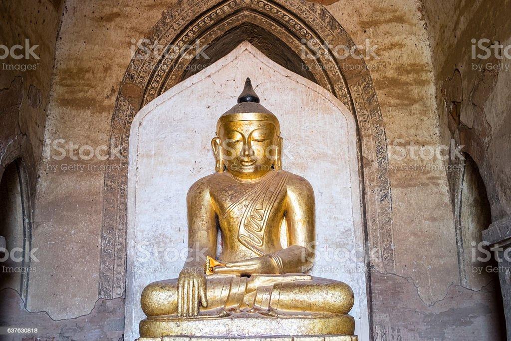 Bagan style Buddha statue in Dhammayangyi temple, Bagan ancient stock photo