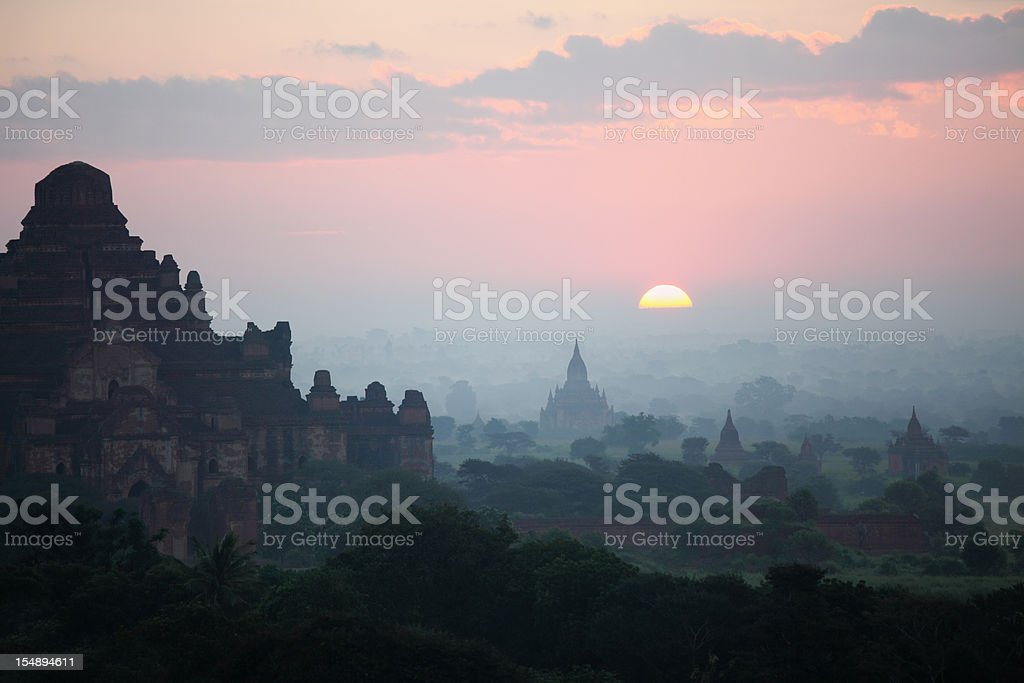 Bagan temple field sunrise royalty-free stock photo