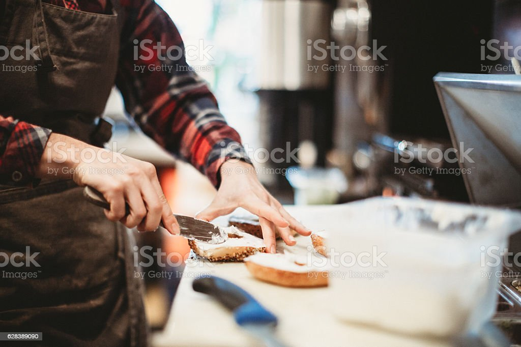 Bagel Preparation In Cafe stock photo