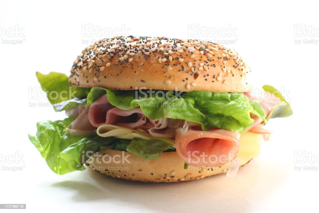 Bagel sandwich with assorted ingredients on white background stock photo