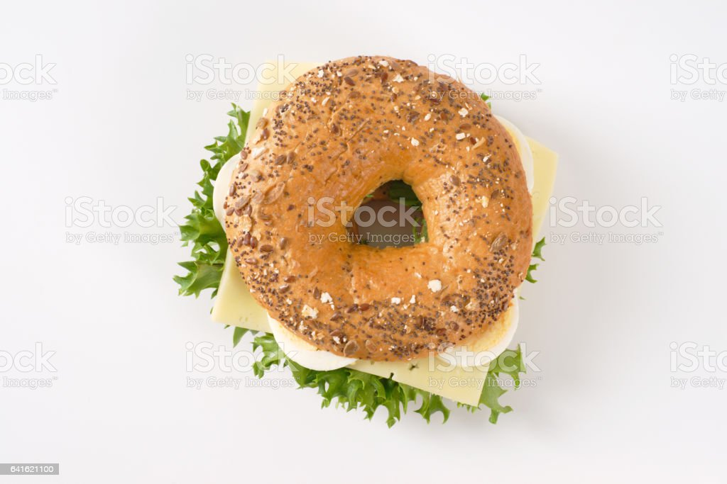 bagel sandwich with eggs and cheese stock photo