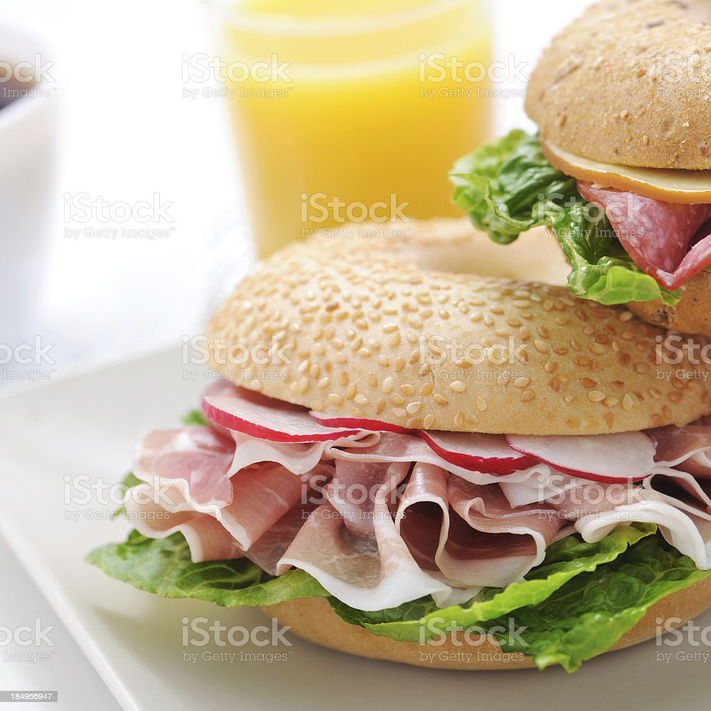 Bagel sandwich with proscuitto ham and radish royalty-free stock photo