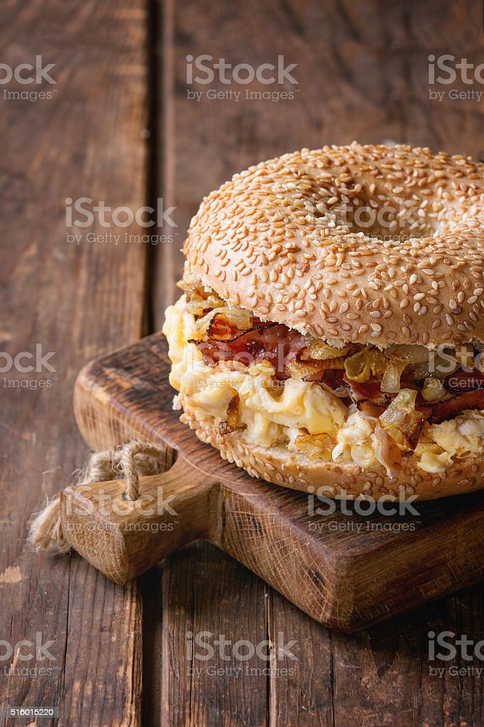 Bagel with bacon and scrambled eggs stock photo