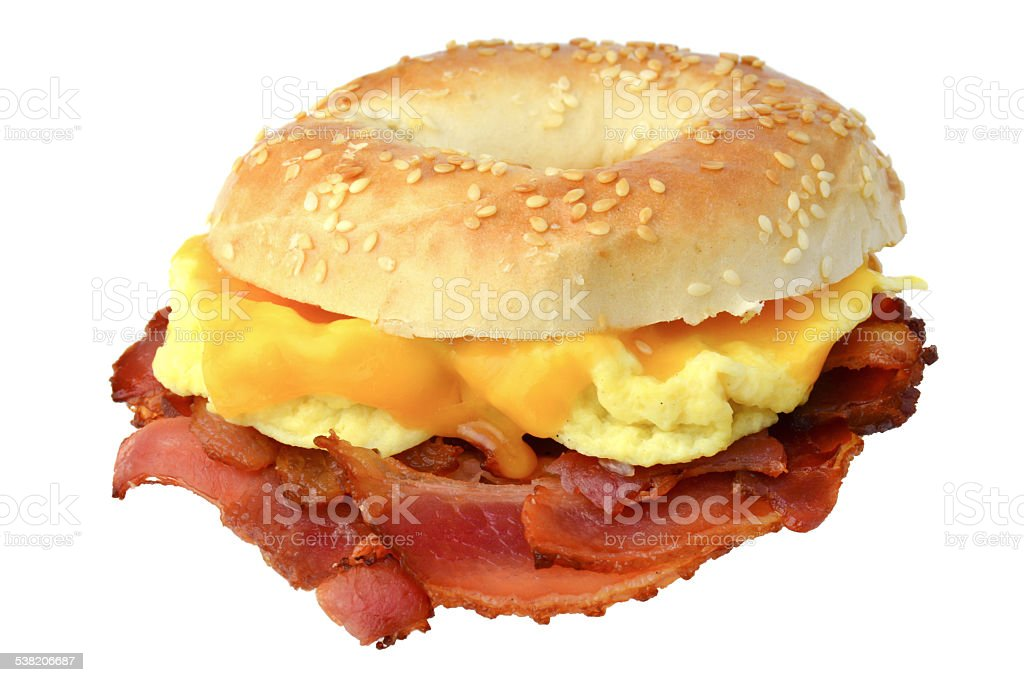Bagel with bacon, scrambled eggs and cheddar cheese stock photo