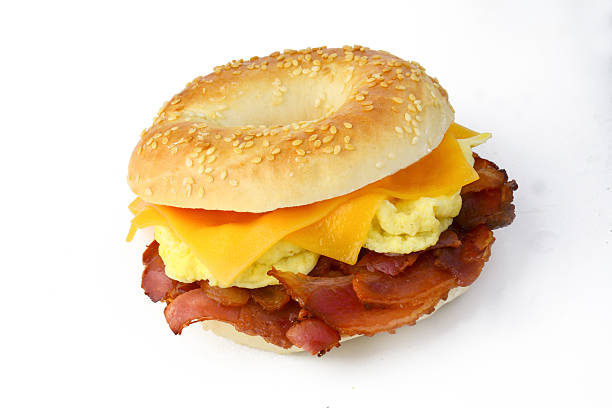 Bagel with egg, cheese and bacon, isolated stock photo