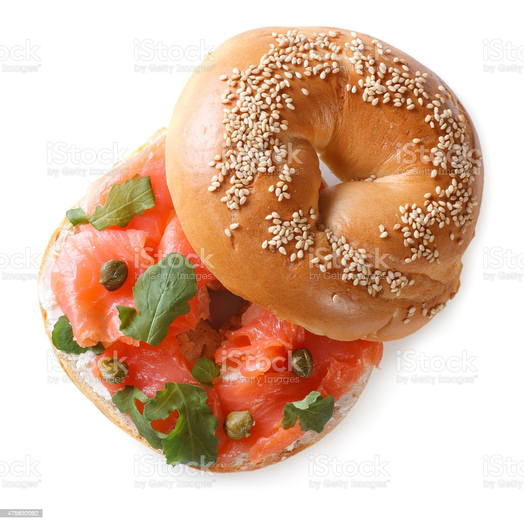 bagel with red fish and soft cheese isolated top view stock photo