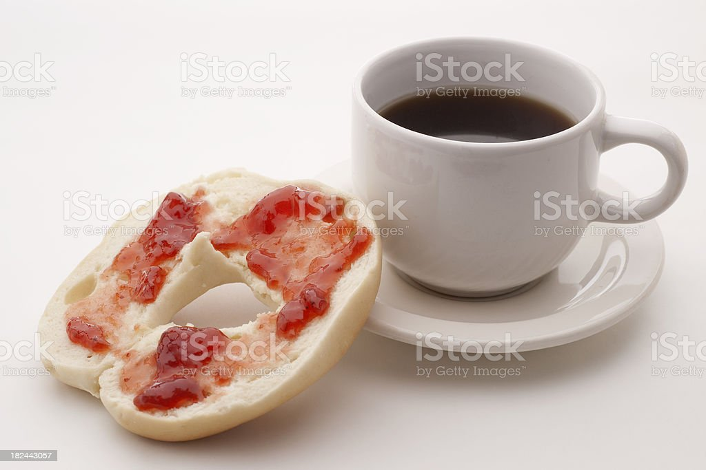 bagel with strawberry preserves and coffee royalty-free stock photo